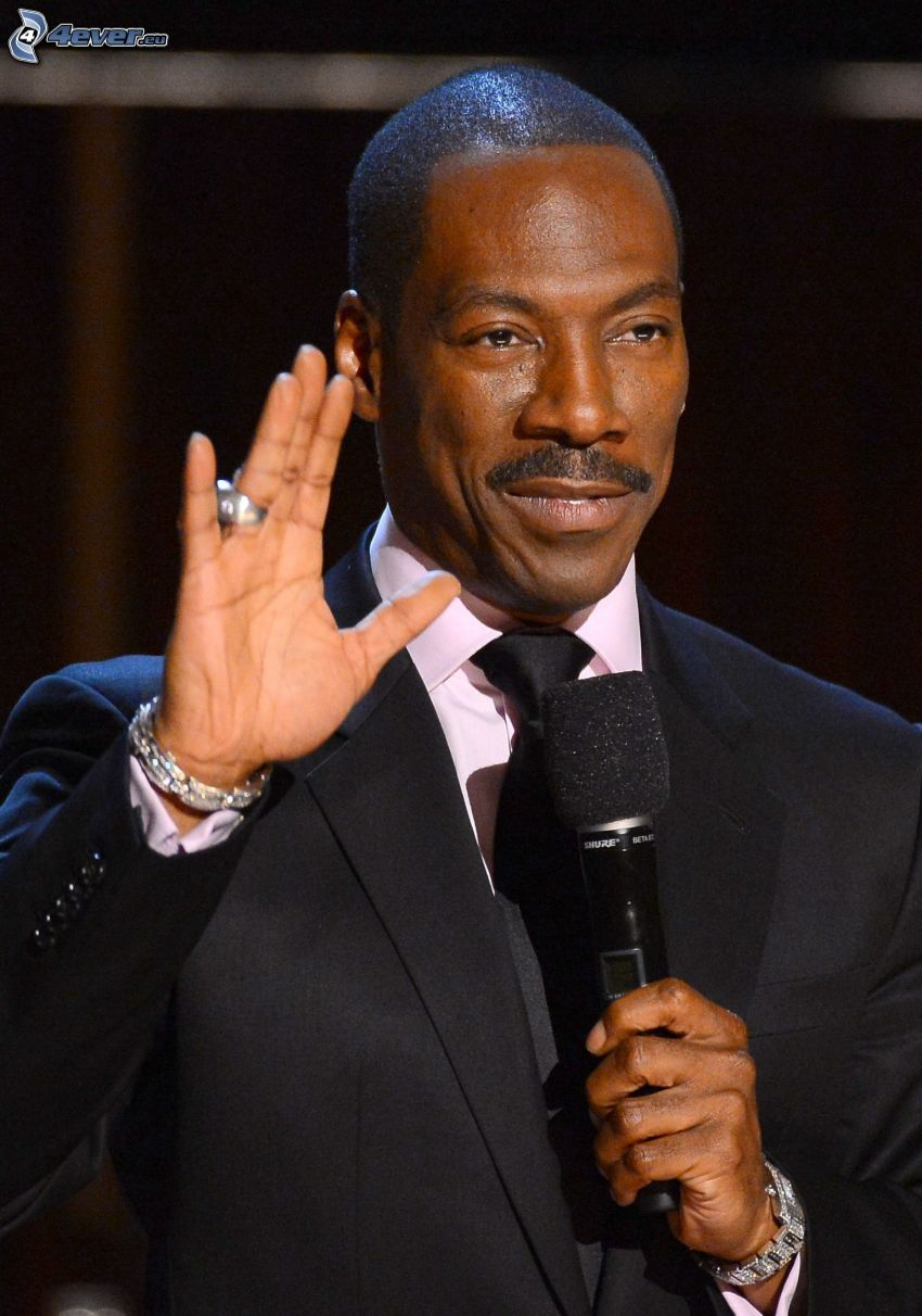 Eddie Murphy, man in suit, microphone, greeting