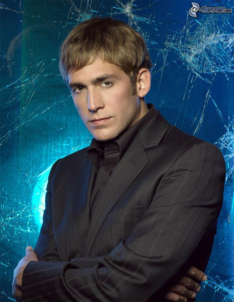 Eric Szmanda, man in suit, broken glass