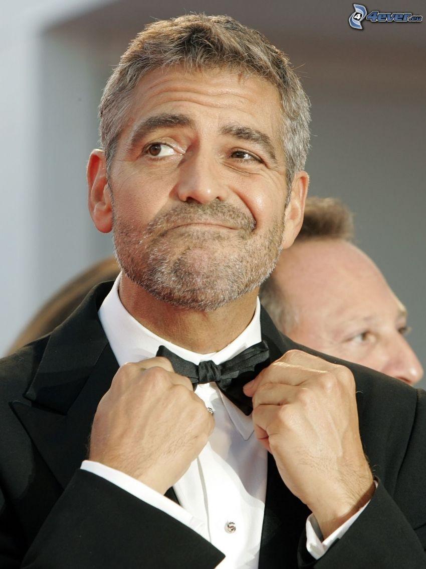 George Clooney, man in suit, bow tie, grimacing