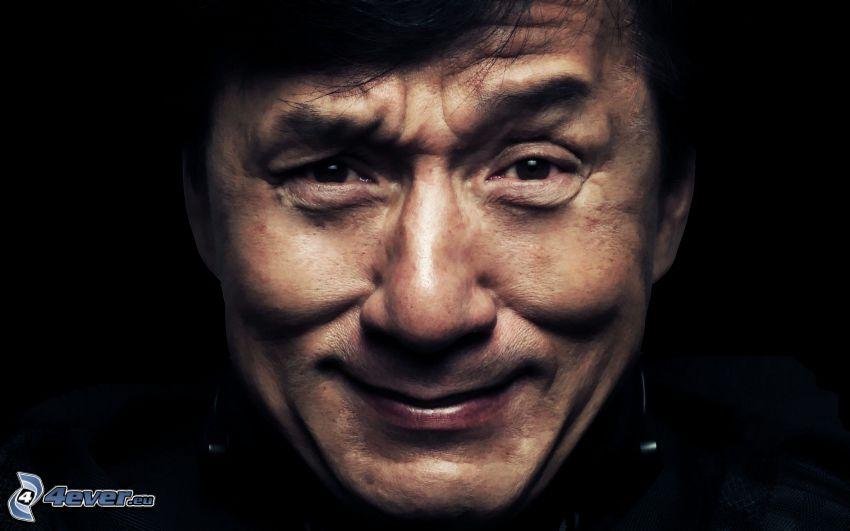 Jackie Chan, grimacing