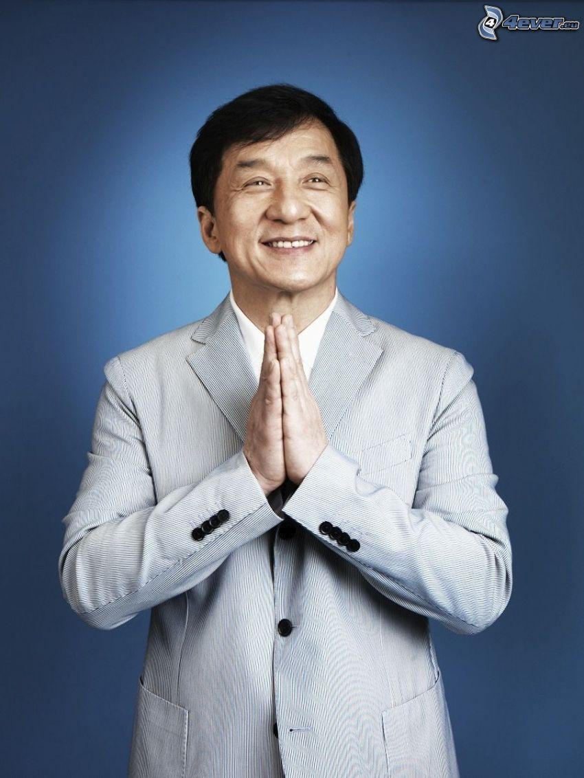 Jackie Chan, man in suit, smile