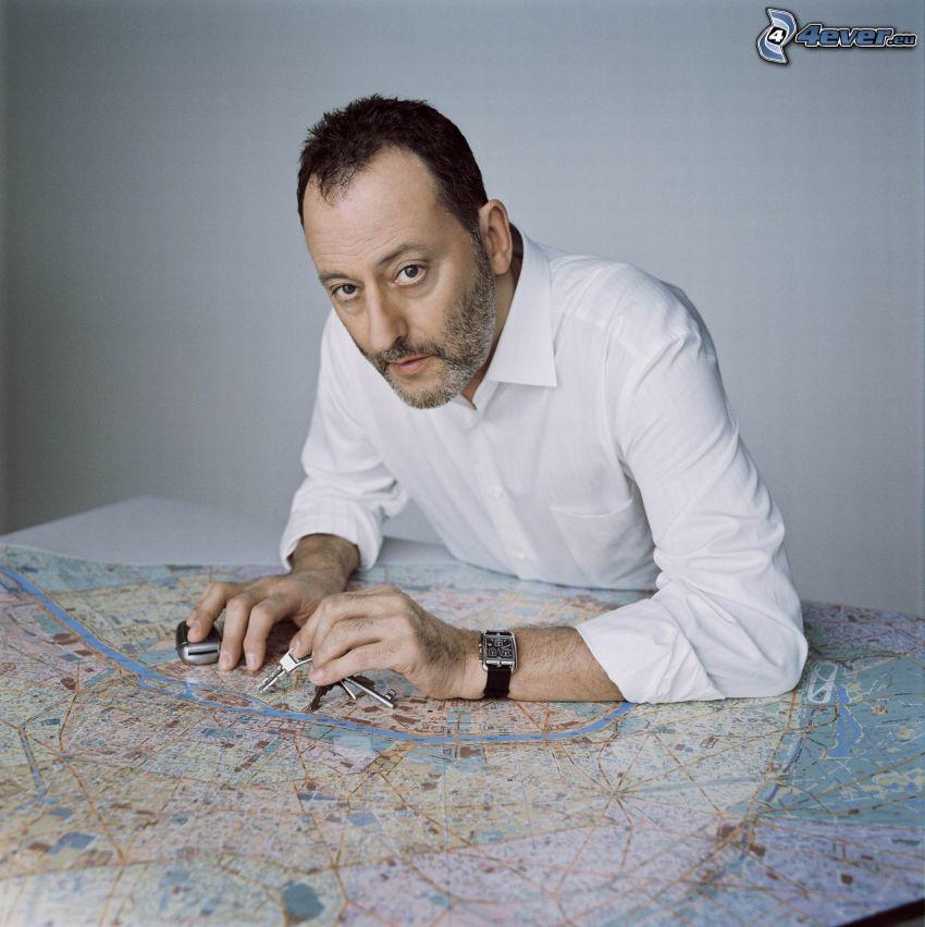 Jean Reno, map, keys, white shirt