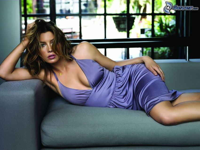Jessica Biel, brunette on the couch, purple dress
