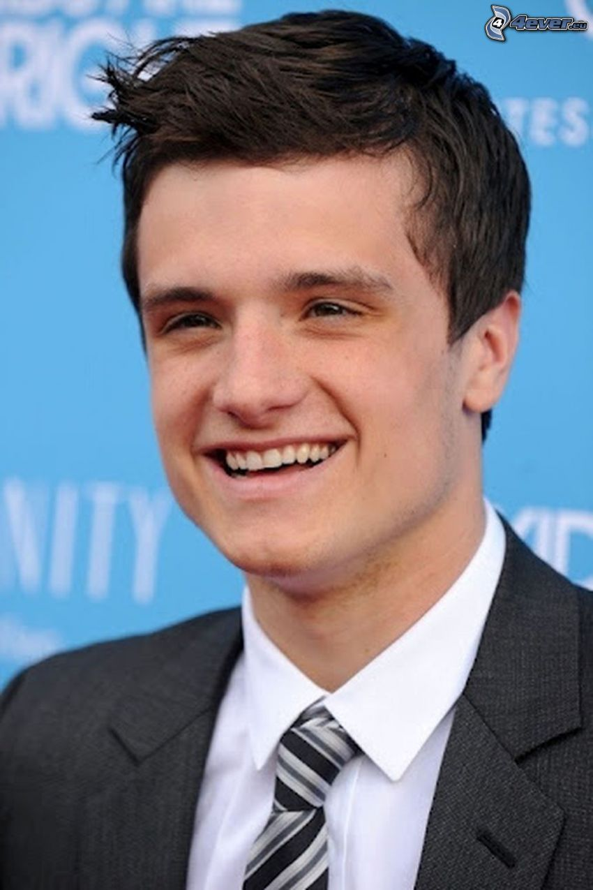 Josh Hutcherson, laughter, man in suit