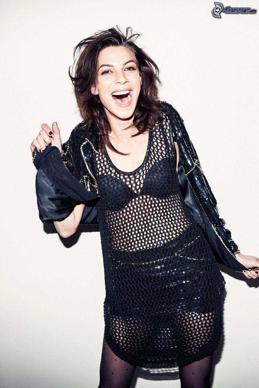Natalia Tena, fishnet dress, laughter