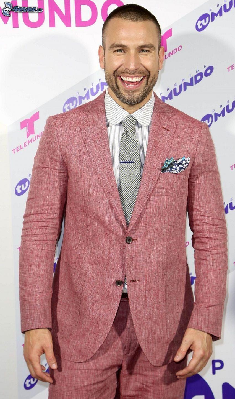 Rafael Amaya, laughter, man in suit