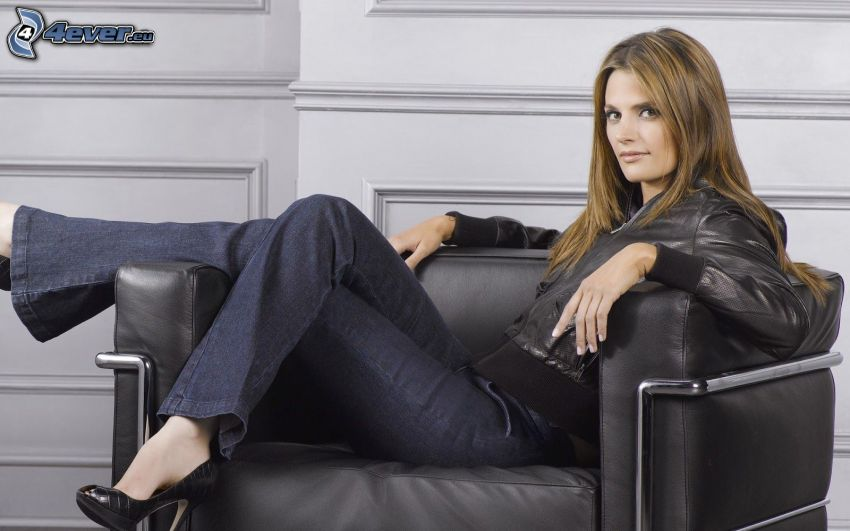 Stana Katic, woman on couch