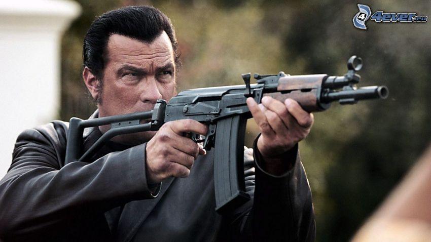 Steven Seagal, man with a gun