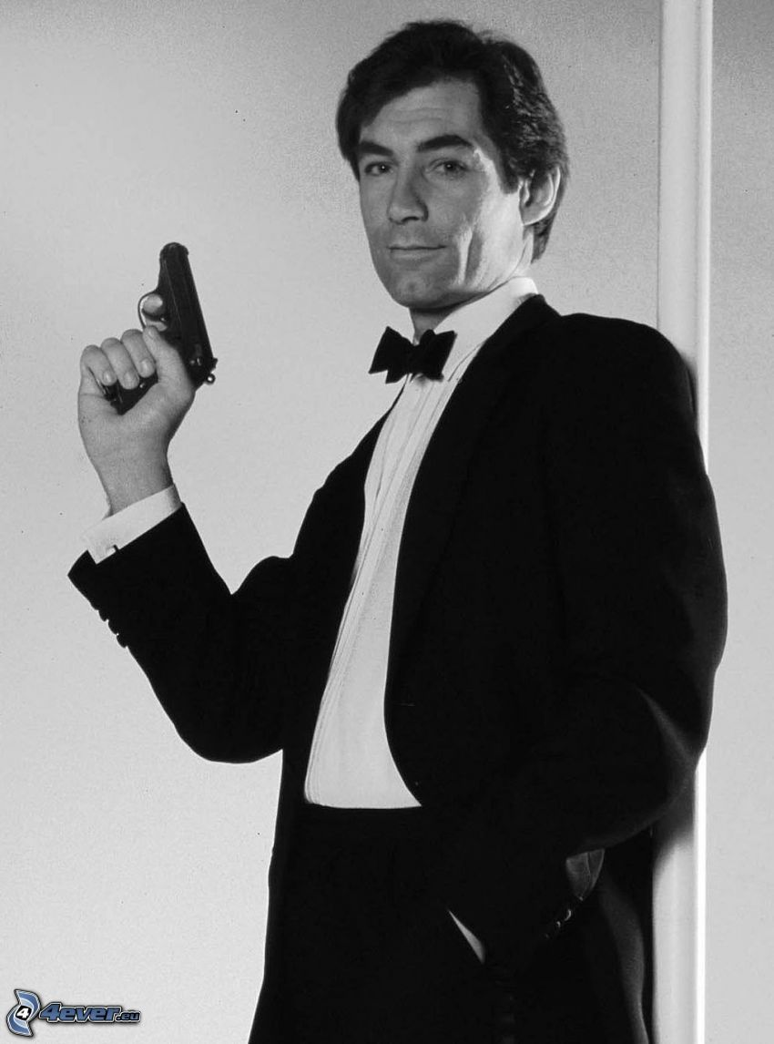 Timothy Dalton, man with a gun, man in suit, young, black and white photo