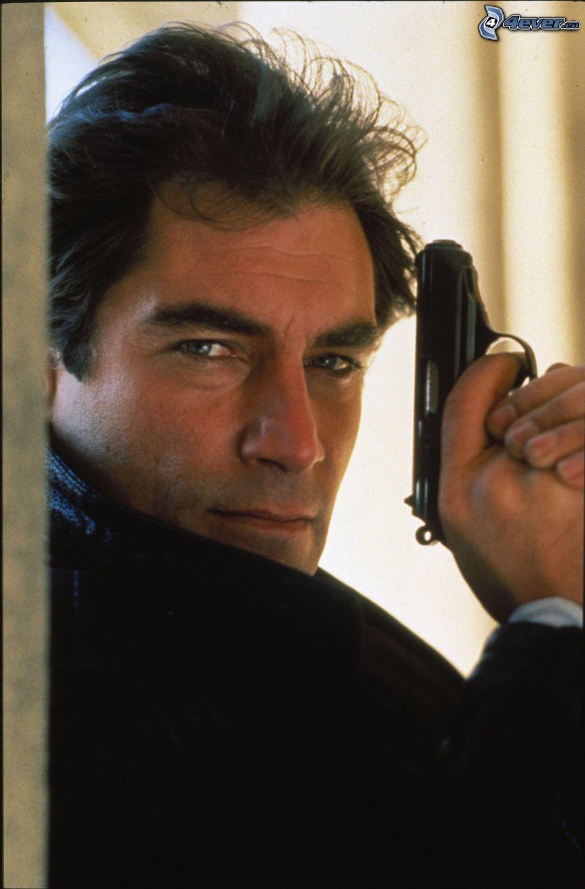 Timothy Dalton, man with a gun