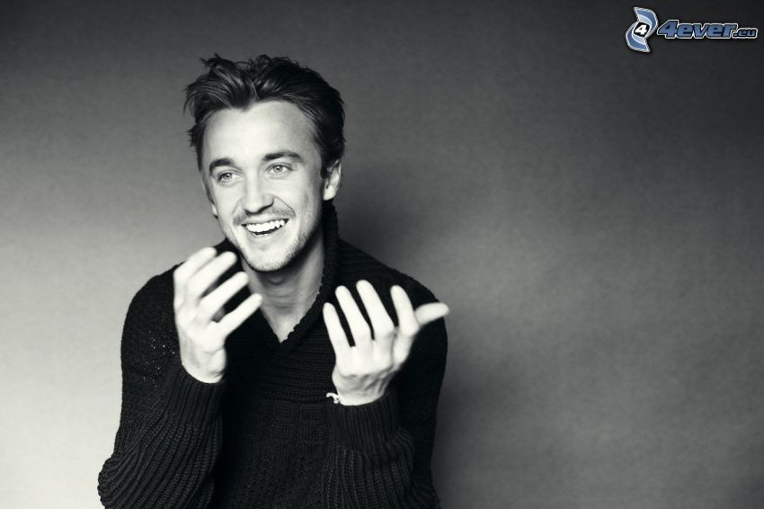 Tom Felton, laughter, black and white photo