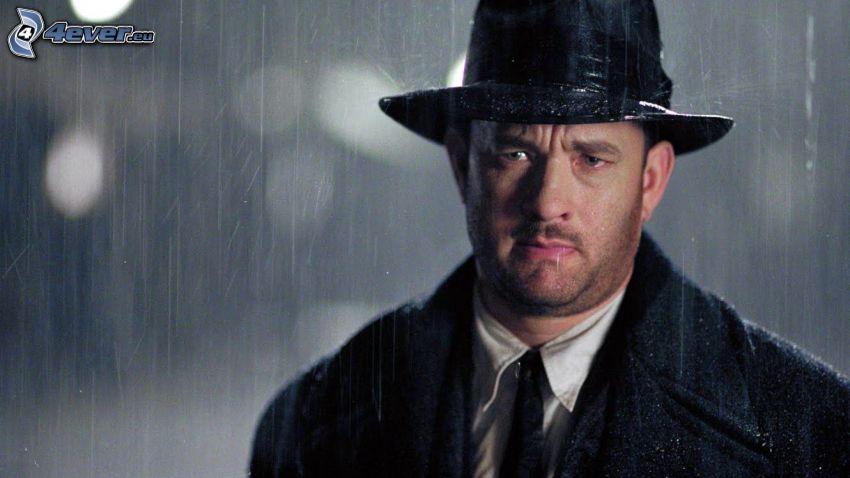 Tom Hanks, a man in hat, rain