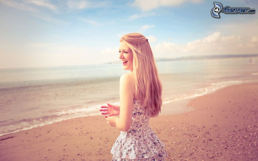 blonde on the beach, sea, laughter
