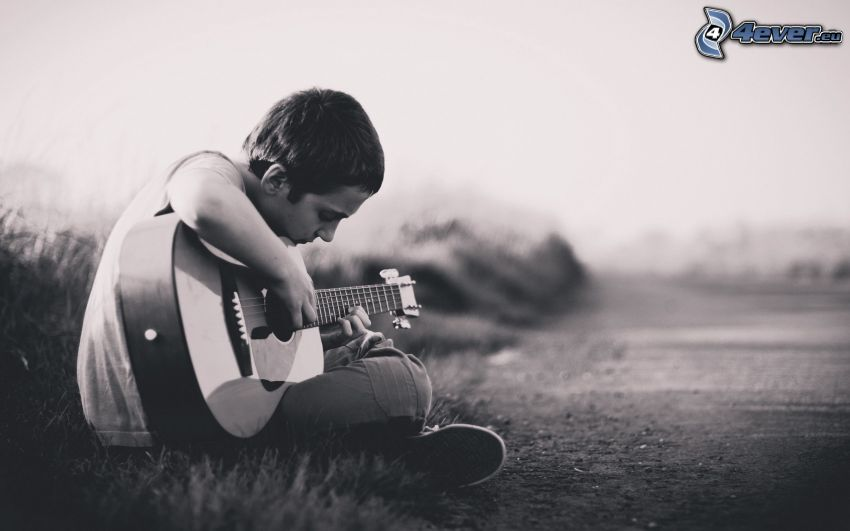 boy with a guitar, black and white photo