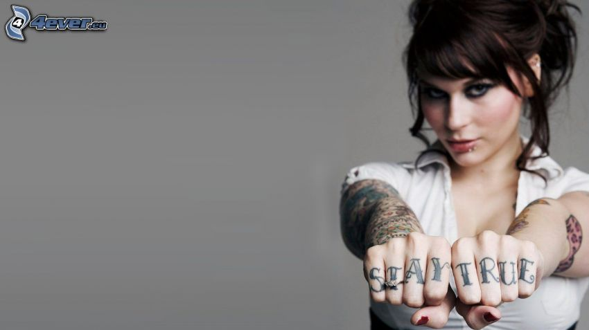 brunette, tattooed woman