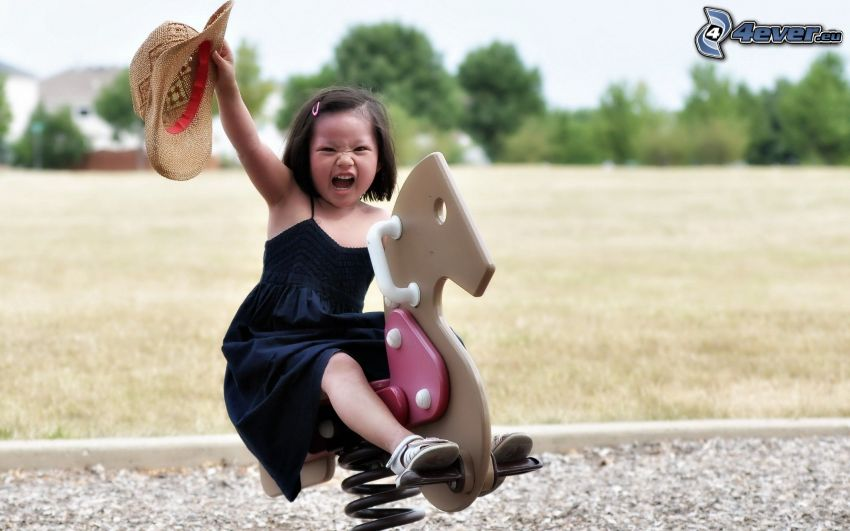 baby, jungle gym, a girl with a hat, grimacing