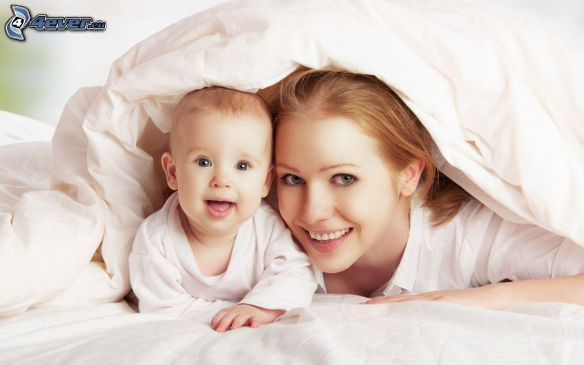 baby with mother, featherbed