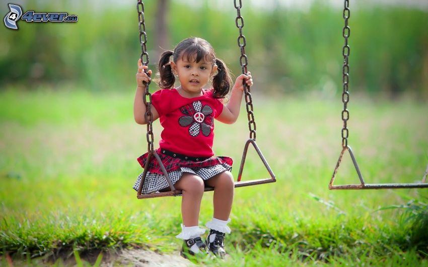 girl on a swing, grass