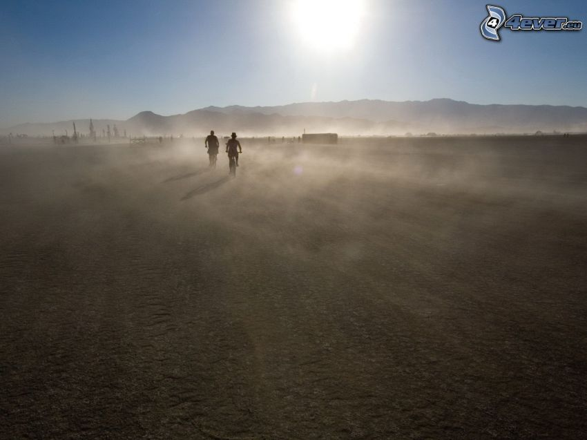 cyclists, silhouettes of people, sun