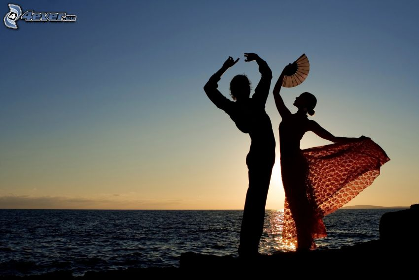 dancers, sunset over the sea, silhouettes of people