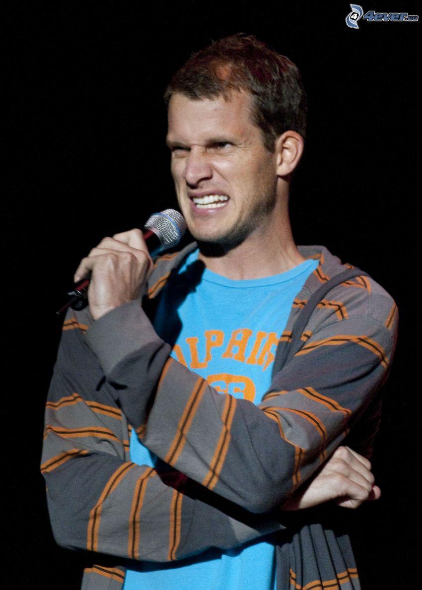 Daniel Tosh, comedian, microphone, grimacing