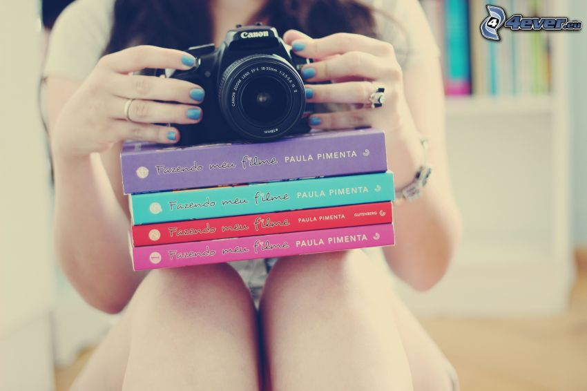 girl with camera, books