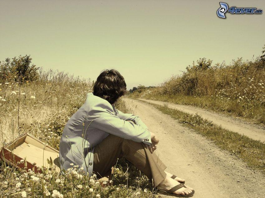 man, field path, suitcase, plants
