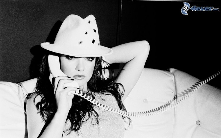 Britney Spears, a girl with a hat, phone, black and white photo