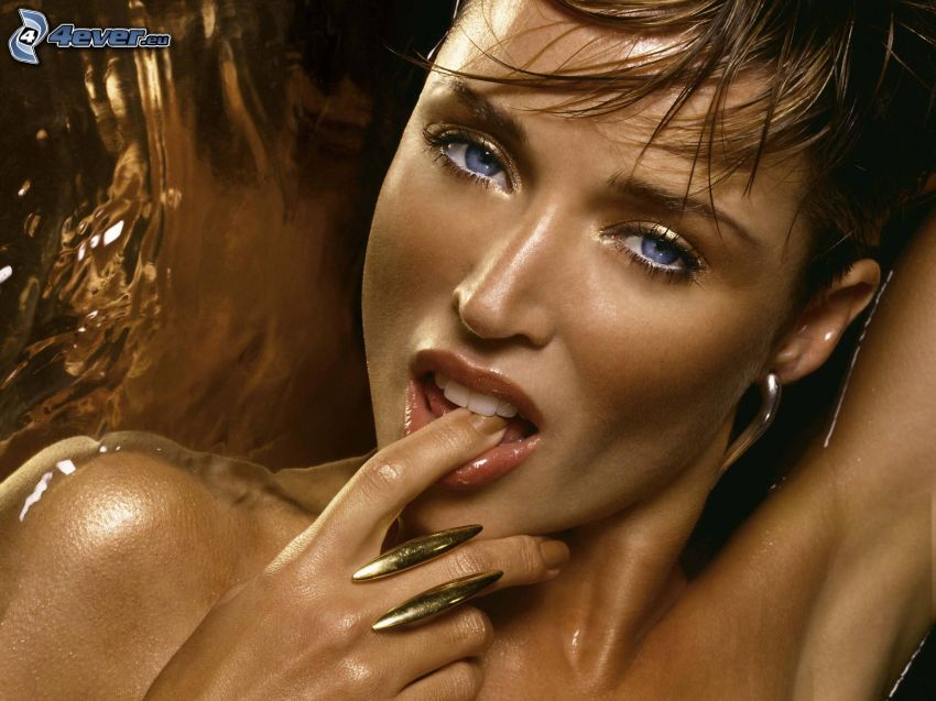 Dannii Minogue, finger in mouth