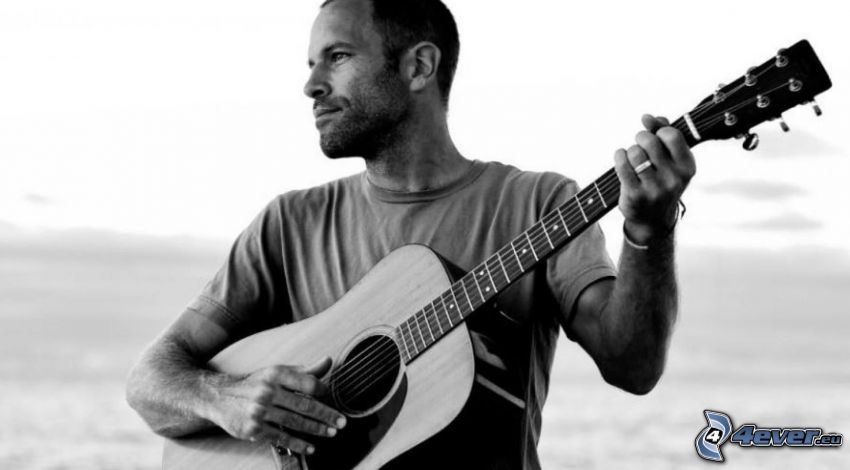 Jack Johnson, playing guitar, black and white photo