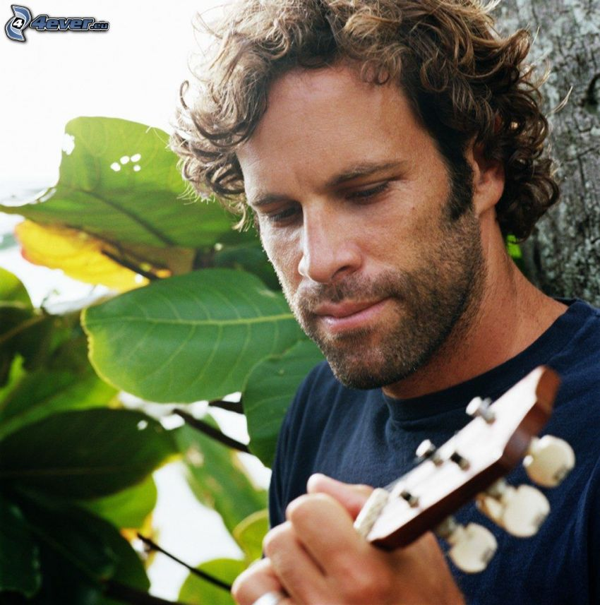 Jack Johnson, playing guitar, green leaves