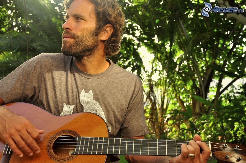 Jack Johnson, playing guitar, look