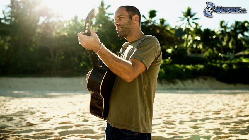 Jack Johnson, playing guitar, palm trees, sandy beach