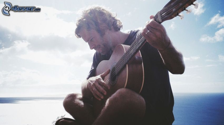 Jack Johnson, playing guitar