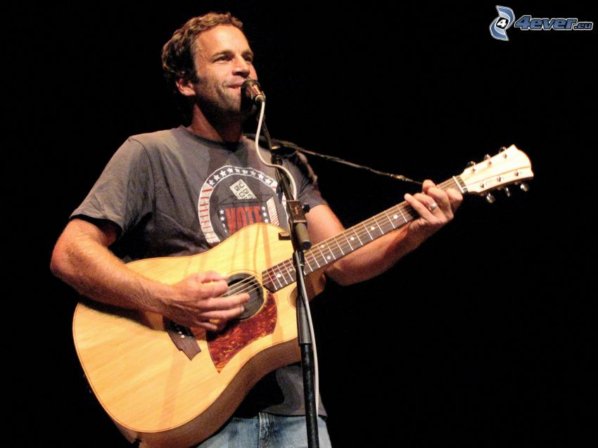 Jack Johnson, singing, playing guitar