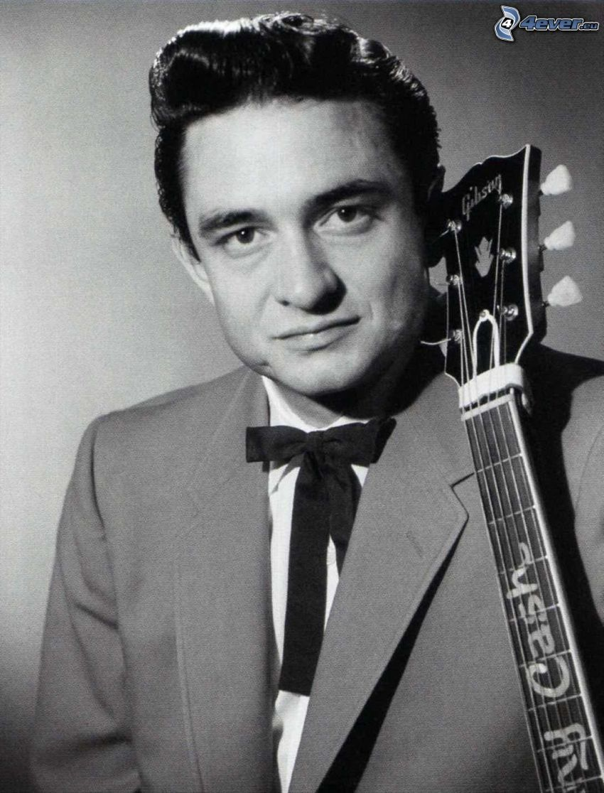 Johnny Cash, man with guitar, black and white photo