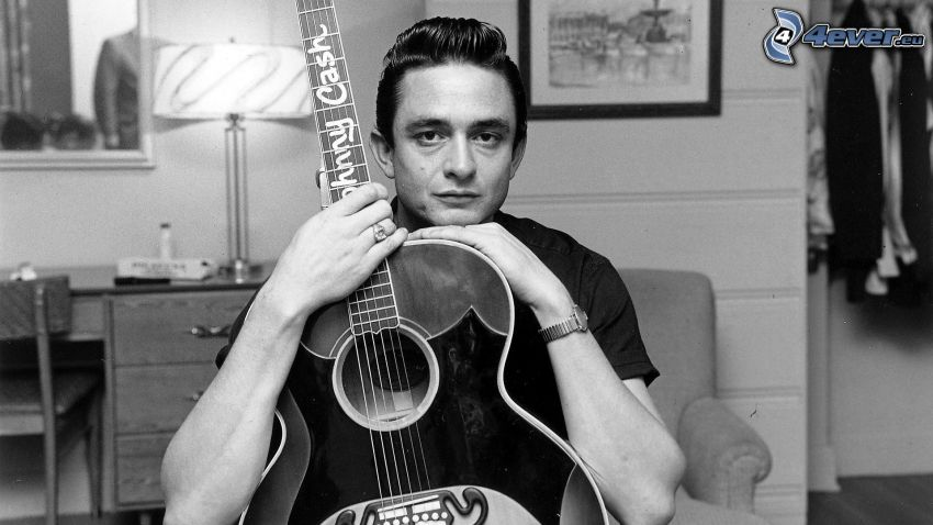 Johnny Cash, man with guitar, young, black and white photo