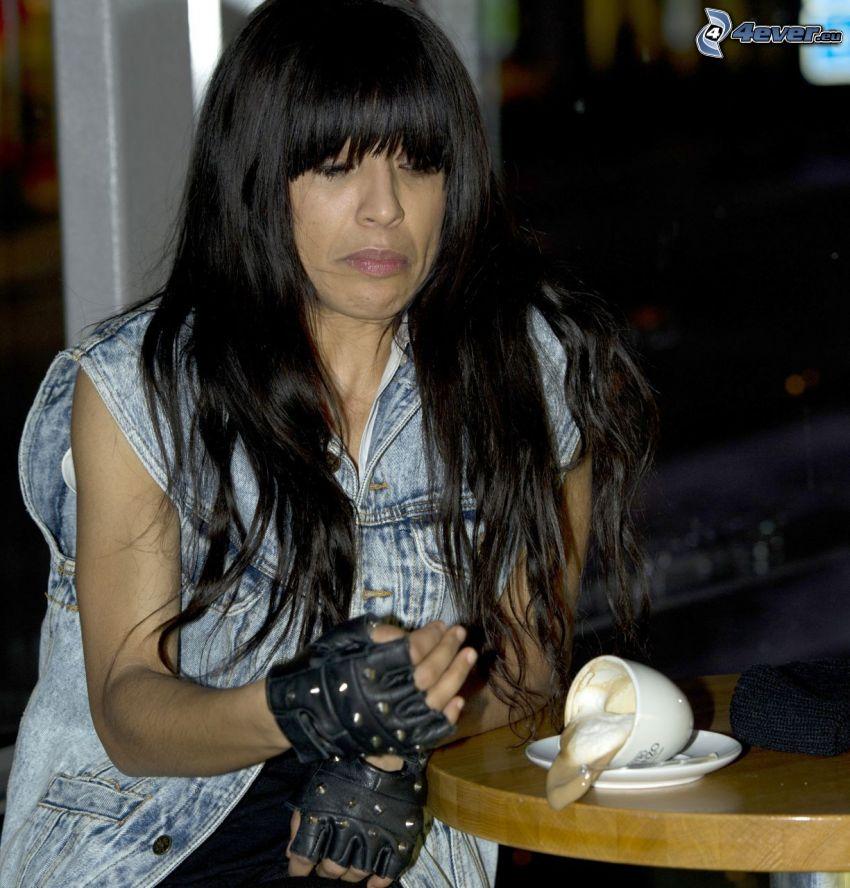 Loreen, grimacing, cup of coffee
