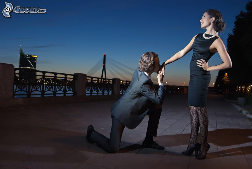 proposing, couple in town, evening city, waterfront