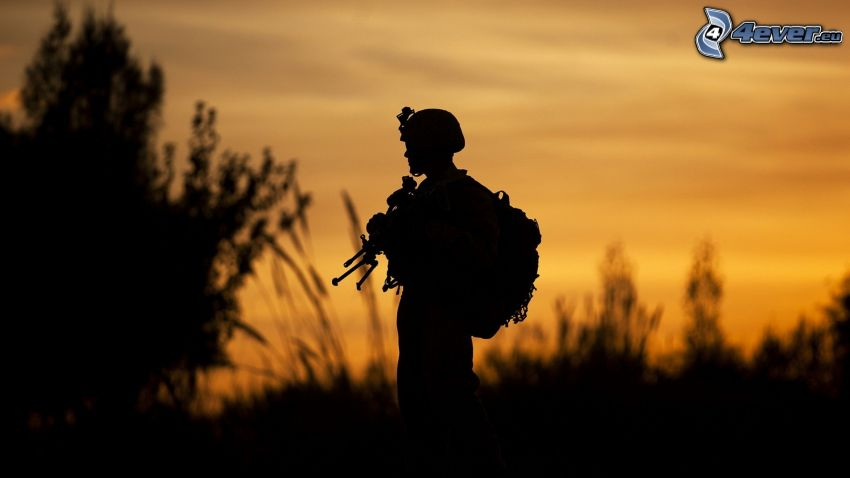 soldier with a gun, yellow sky, silhouette