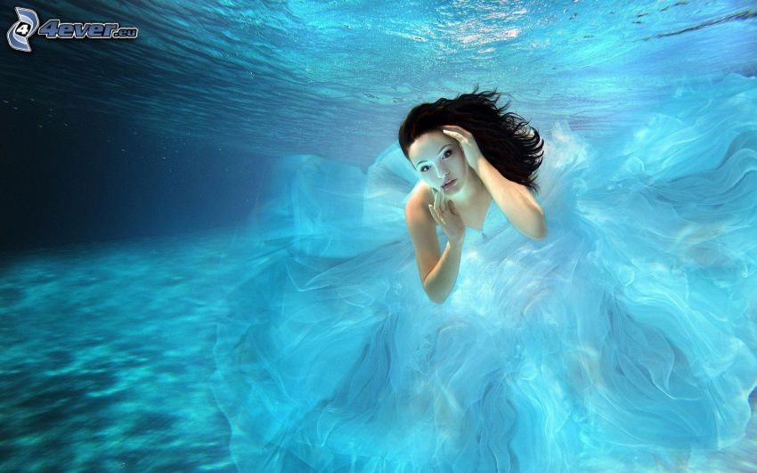 swimming underwater, woman