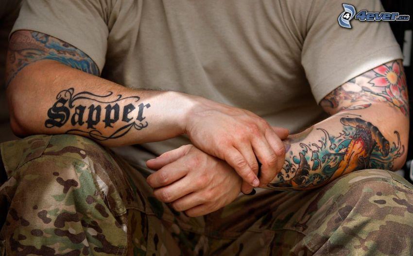 tattooed guy, hands