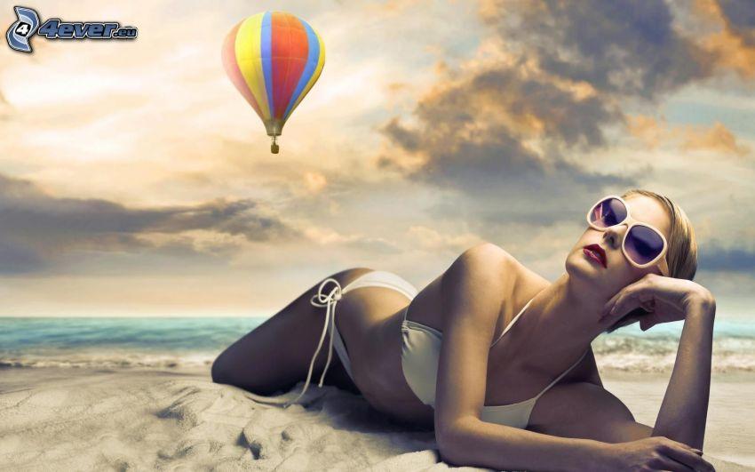 woman on the beach, sunbathing, hot air balloon, beach