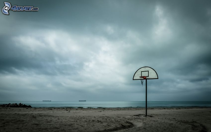 basketball basket, beach, open sea, dark clouds