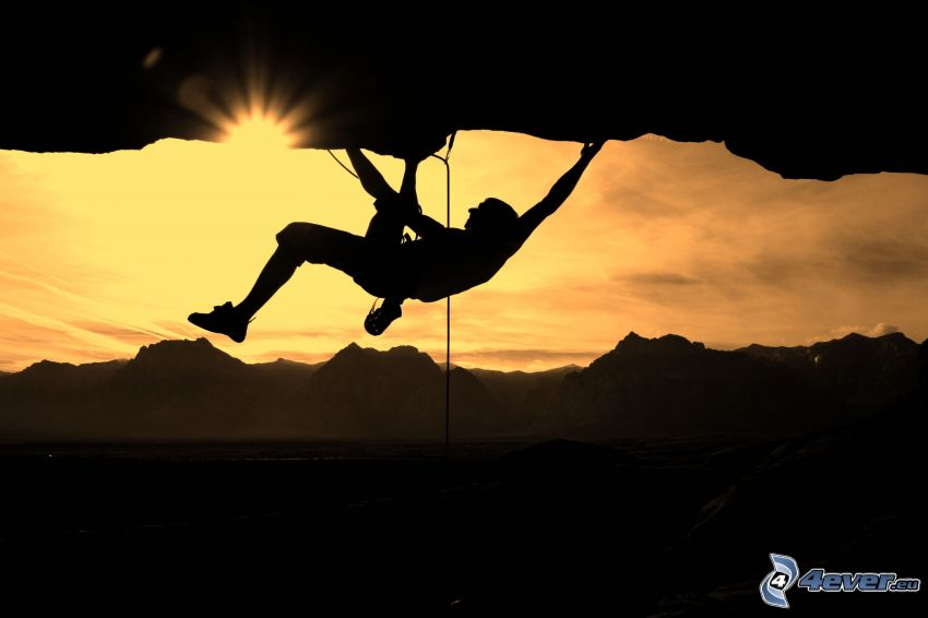 climber, silhouette of a man, sun, rocky mountains