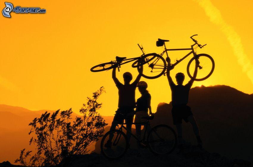 Bikelift, cyclists, mountains, yellow sky
