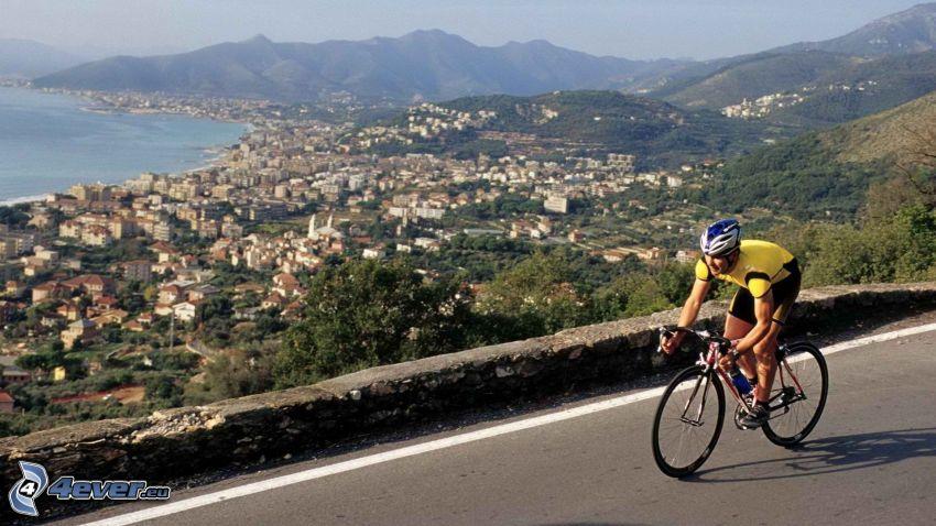 cyclist, seaside town