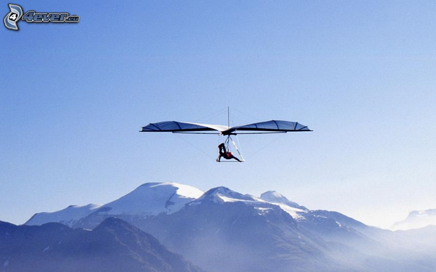 hang gliders, snowy mountains
