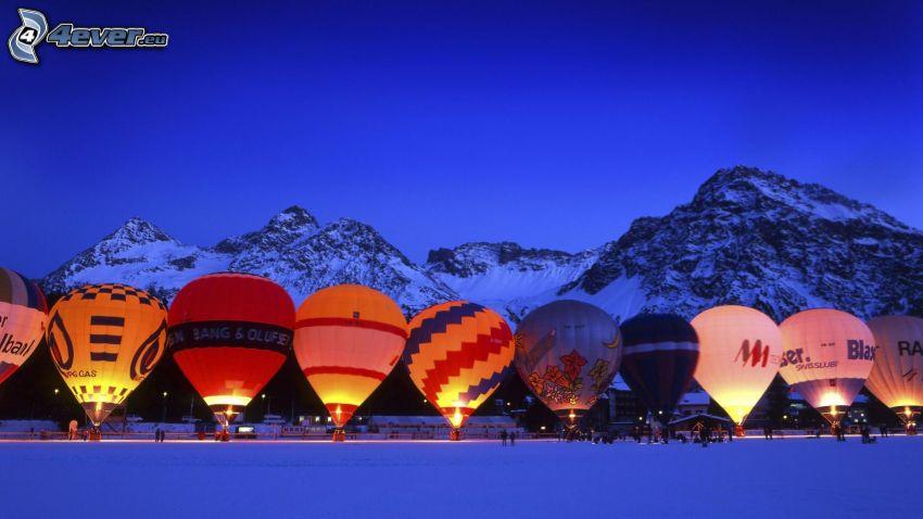 hot air balloons, snowy mountains