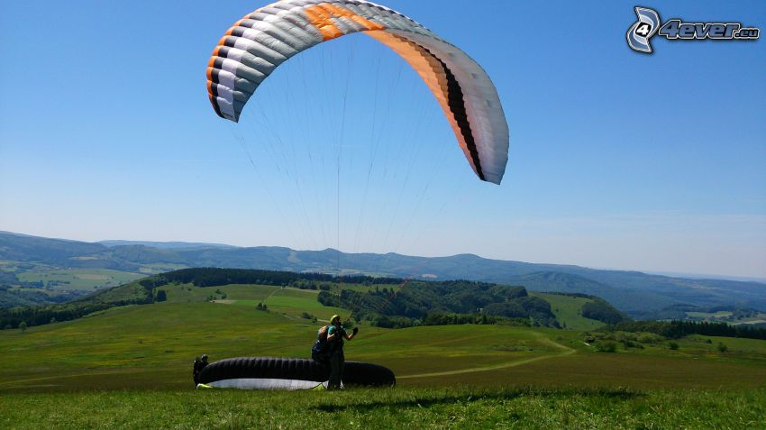 paragliding, forests and meadows